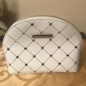 Michael Kors white and silver cosmetic bag. NWOT.